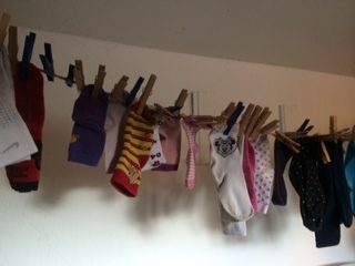 Mismatched socks on a clothes line